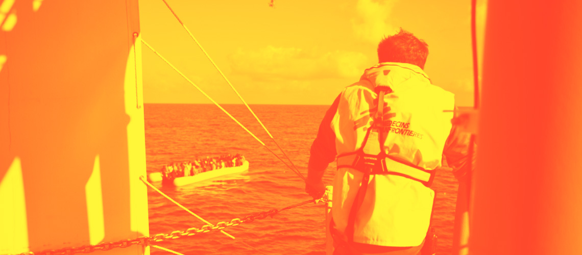 Henry Gray, MSF field coordinator on the Bourbon Argos, looks at one of the inflattable boats few minutes before they are being rescued on June 1st 2015 in the Meditetranean sea off the Libyan Coast.